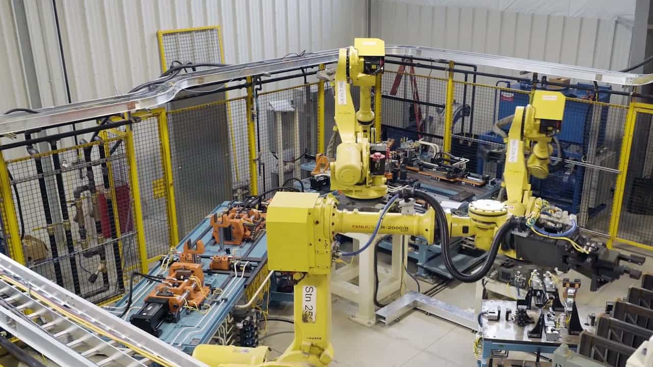 Automated Assembly cell with material handling robots