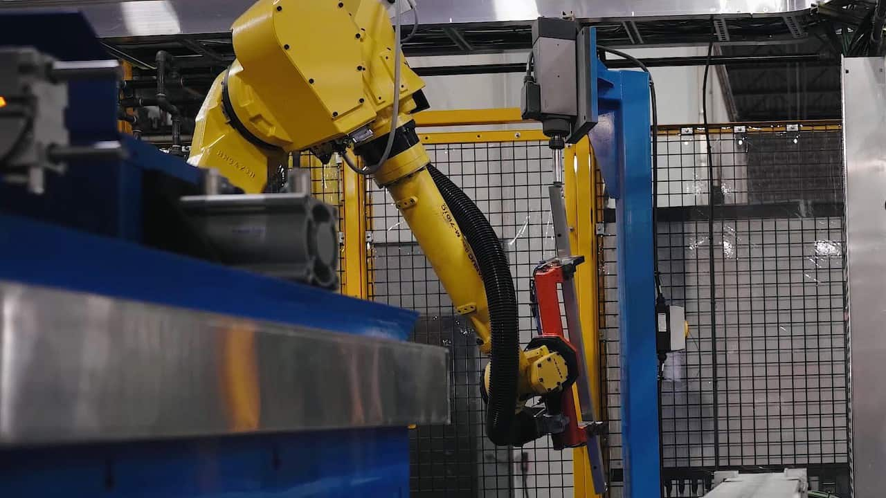 Automated deburring station for automotive assembly system